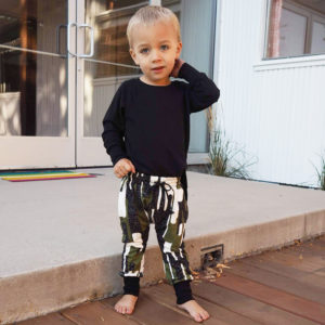 Theo wearing the track pants and raglan